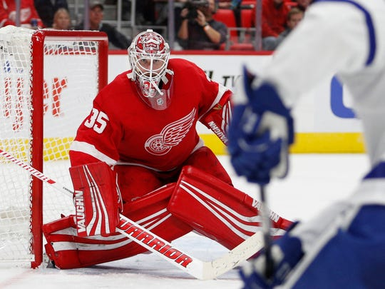 Red Wings goalie Jimmy Howard (35) prepares for a shot from Maple Leafs center Tyler Bozak (42) during the third period of the Wings' 4-2 exhibition loss on Friday, Sept. 29, 2017, at Little Caesars Arena.