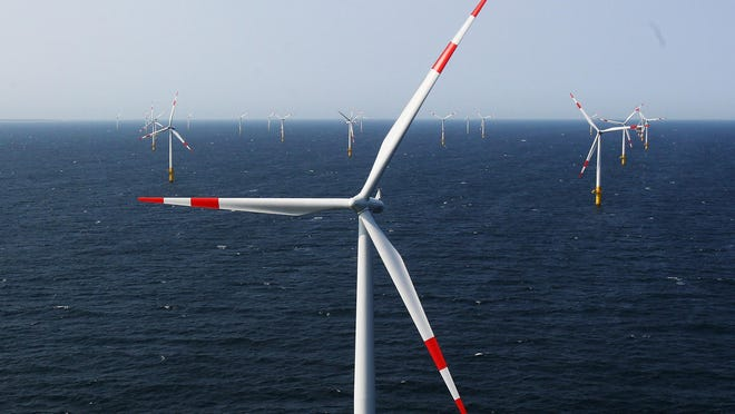 "Wind turbines stand in the Baltic 1 offshore wind farm in 2011 in the Baltic Sea near Zingst, Germany. New research published on Monday finds there is so much wind energy potential over oceans that it could theoretically be used to generate ""civilization scale power."""