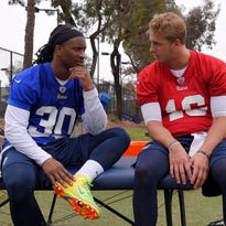 FILE - In this June 1, 2016, file photo, Los Angeles Rams running back Todd Gurley , left, talks with quarterback Jared Goff during NFL football practice in Oxnard, Calif. The Rams' hopes are built around a revitalization of the NFL's worst offense last season. They're placing an enormous bet on the developing talents of No. 1 draft pick Jared Goff at quarterback and budding star Todd Gurley at running back. (AP Photo/Mark J. Terrill, File)