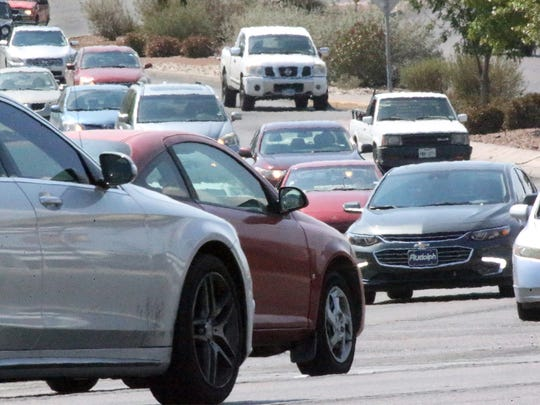 Drivers make their way along both directions of N. Mesa Street near the intersection with Executive Center Boulevard on Monday.
