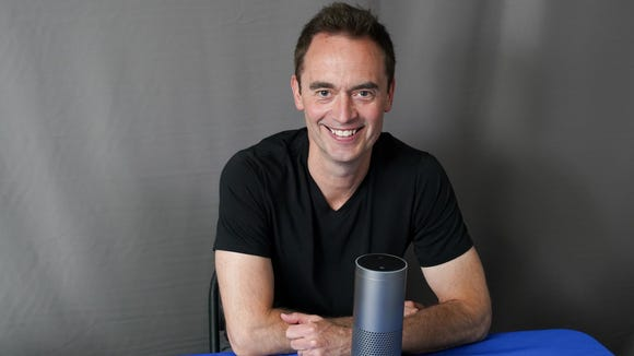 Steve Boom, the vice-president of Amazon Music, with an Echo device, in the Talking Tech garage