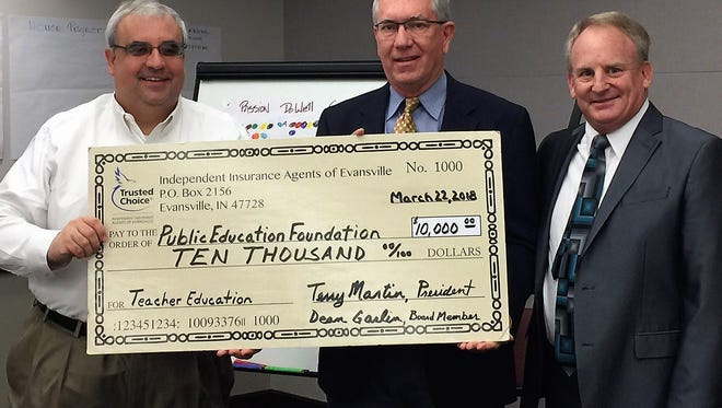 Development Grant - Representatives from the Independent Insurance Agents of Evansville attended the Public Education Foundation's monthly Board meeting recently to present them with a check for $10,000 in support of teacher professional development grants. The Foundation make the grants available each spring to teachers in Vanderburgh County's public schools. From left are PEF President Andy Ozete receiving the check from Independent Insurance Agents' Board member Dean Gaslin (Gaslin Insurance) and Board President, Terry Martin (Schultheis Insurance).