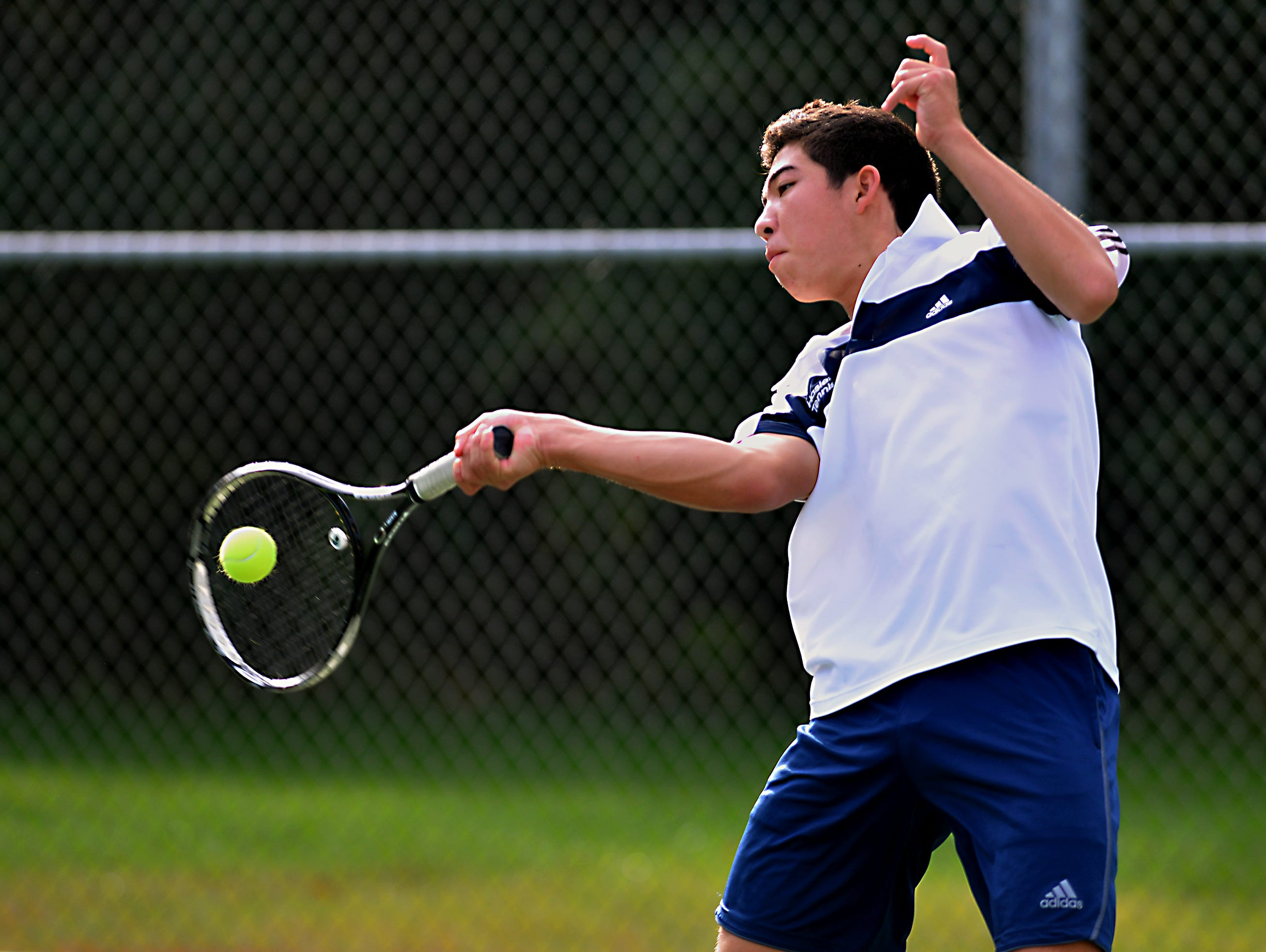 Haslett's Nate Choi hits a forehand Thursday 10/8/2015 in early action of tennis regionals.