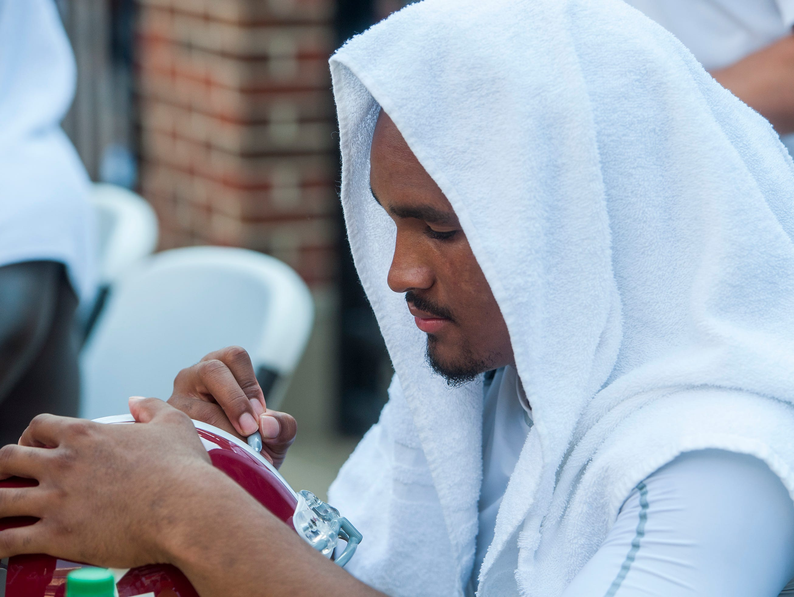 Alabama quarterback Jalen Hurts (2) signs autographs during fan day in Tuscaloosa, Ala. on Saturday August 5, 2017.