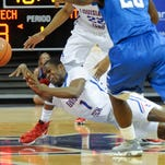 Louisiana Tech freshman guard Derric Jean passes the ball as he dives to the floor in Thursday's game against Middle Tennessee.