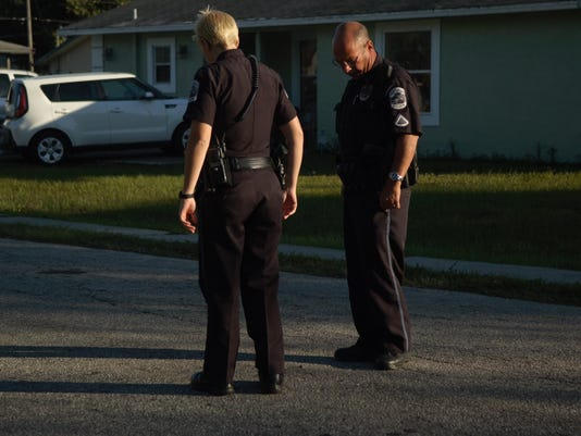 FMPD officers at Davis and Lincioln look for bullet casings after a report of shotrs fired in the area