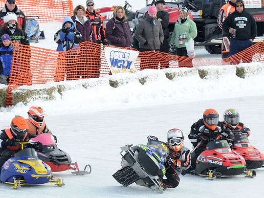 Kids snowmobile race during Sunday's Wausau 525 snowmobile championship at Sunny Vale Park in Wausau, Jan. 30, 2011.