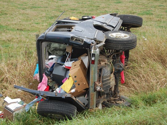 An SUV rolled several times after hitting a tractor