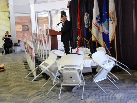 In the ceremony, Hartnell Trustee Candi DePauw conducted the formation of a battlefield cross — symbolic of a soldier's grave site — while Trustee President Manuel Osorio honored prisoners of war and soldiers missing in action with an empty table that sat six empty chairs for each of the military branches.