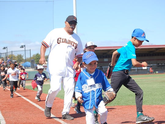Ernie Camacho, a Salinas native and former Major League Baseball pitcher, teaches a free baseball clinic for youth at Hartnell College Saturday.