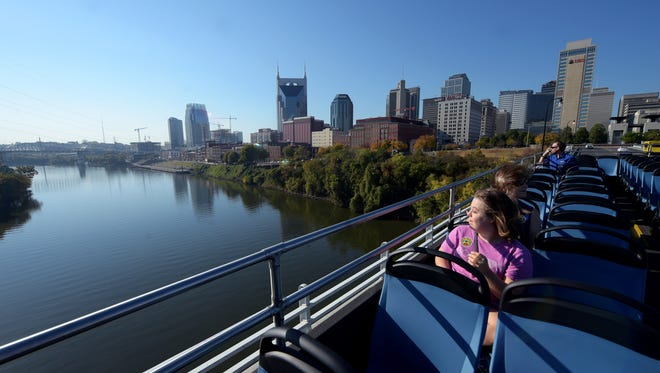 Samantha Gordon looks over Cumberland River while on a double-decker bus called the  Music City Hop which is part of Grayline Tours. A group of tourists took a morning  guided tour of Nashville on Tuesday, Nov. 1, 2016.