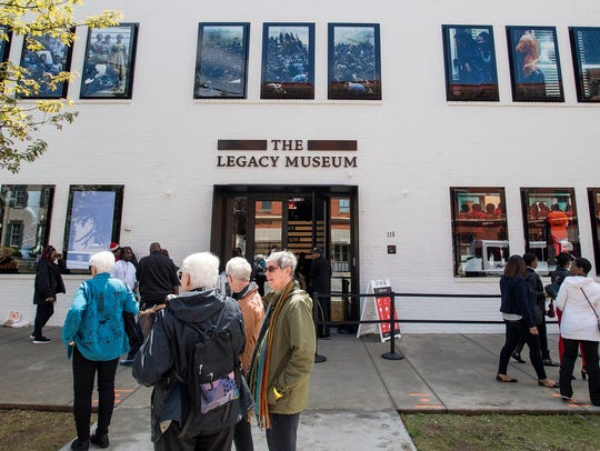 People gather at the opening of The Legacy Museum in