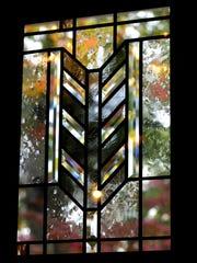 Cut glass filters light through the front door Oct.