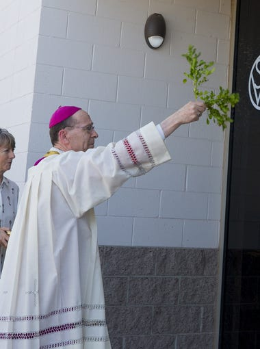 Bishop Thomas Olmsted blesses St. Vincent de Paul's new building on its main downtown campus in Phoenix on May 18, 2018. The building houses a new family resource center and an expanded shelter for the elderly, disabled, and homeless.