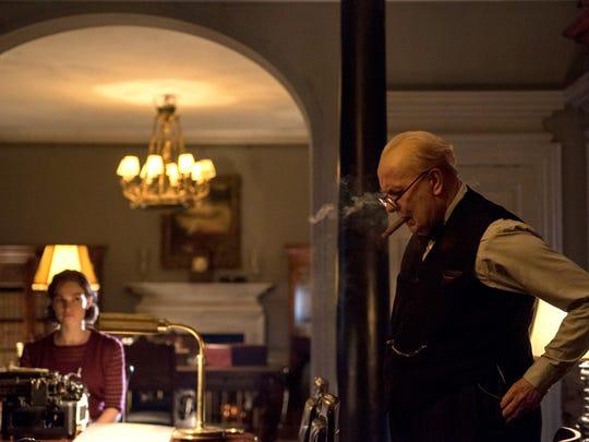 "Lily James stars as Elizabeth Layton and Gary Oldman as Winston Churchill in director Joe Wright's ""Darkest Hour."""