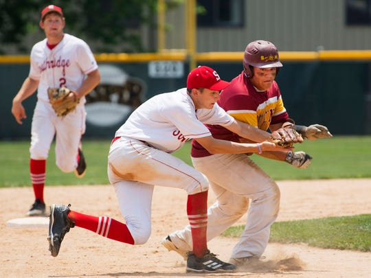 Southridge's Colson Montgomery, center, catches a line drive and tags Indianapolis Scecina Memorial runner Sebastian Martinez for the double-play during the Class 2A Jasper Semi State at Alvin C. Ruxer Field in Jasper, Ind., Saturday afternoon. The Raiders beat the Crusaders 7-2 to advance to state next week.
