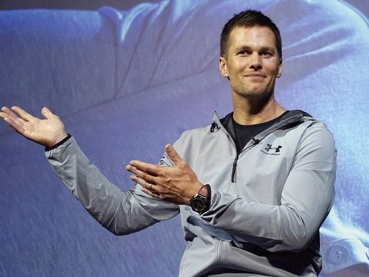 """FILE - In this June 22, 2017, file photo, New England Patriots quarterback Tom Brady gestures during a promotional event in Tokyo. The Boston Globe and Fox News reported on Thursday, July 27, 2017, a search for """"New York Jets owner"""" returned Brady as the top result. The glitch was fixed later in the day and Google declined comment on the issue. (AP Photo/Eugene Hoshiko, File)"""