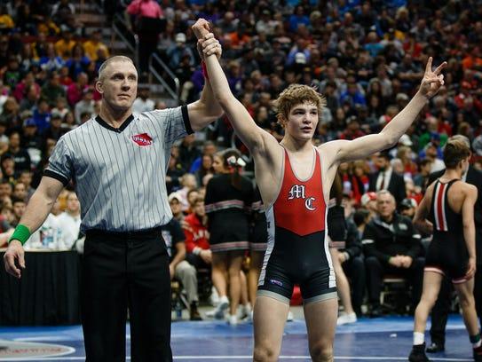 Cullan Schriever of Mason City celebrates after defeating