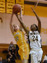 North Farmington senior Kierra Crockett (right) battles
