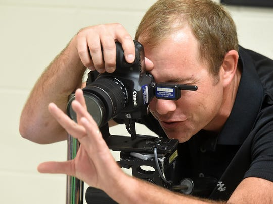 Bryan Johnson of Wingard Photography photographs a student on Wednesday during school picture day at Norfork High School.