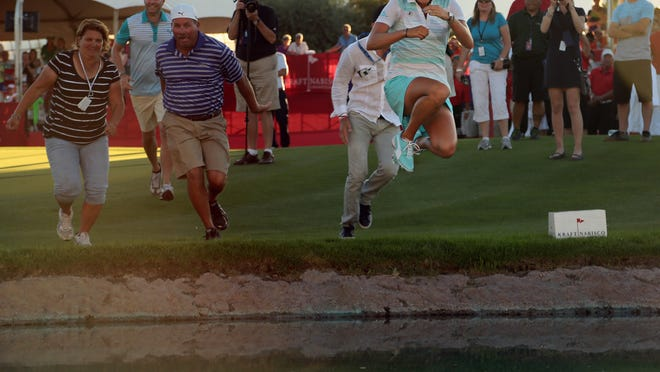 Lexi Thompson jumps into Poppie's Pond in April after winning the Kraft Nabisco Championship in Rancho Mirage.