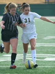 Rider junior Emma Baley (31) battles for control of