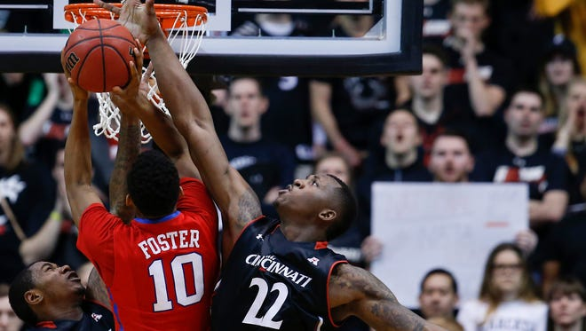 Cincinnati Bearcats center Coreontae DeBerry (22) blocks a shot by Southern Methodist Mustangs guard Jarrey Foster (10) in the first half during the NCAA basketball game between the Southern Methodist Mustangs and the Cincinnati Bearcats, Sunday, March 6, 2016, at Fifth Third Arena in Cincinnati.