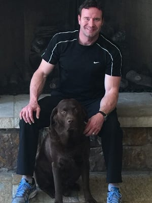 Buddy Lazier and his dog, Speed.