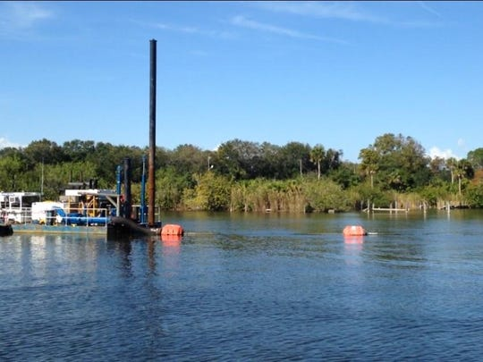 A dredge sat idle Tuesday in Turkey Creek. Brevard County spent more than $7 million, using state money, to dredge muck from the creek to improve water quality in the Indian River Lagoon.
