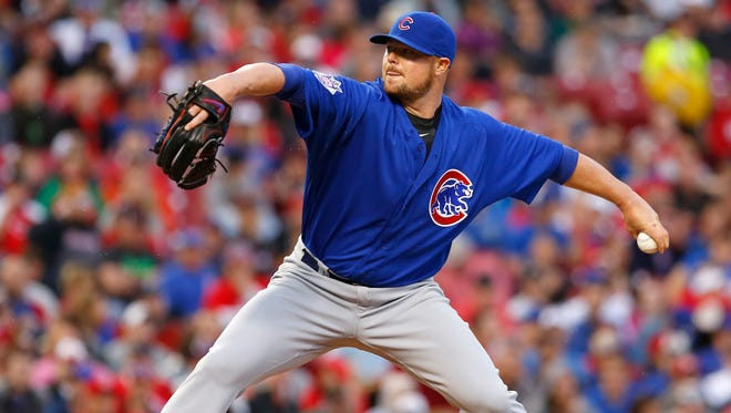 Chicago Cubs starting pitcher Jon Lester throws a pitch against the Cincinnati Reds during the second inning at Great American Ball Park.