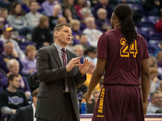 Loyola Ramblers head coach Porter Moser talks with