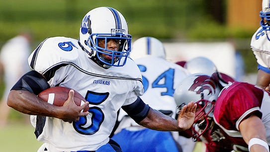 Godby running back Roy Upchurch (5) ran past, through
