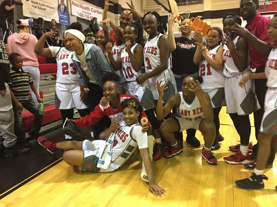 The North Caddo girls basketball team celebrates after