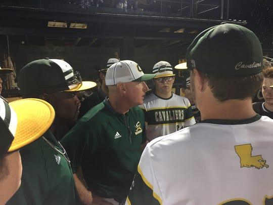 Calvary coach Shannon Cunningham talks with his team.