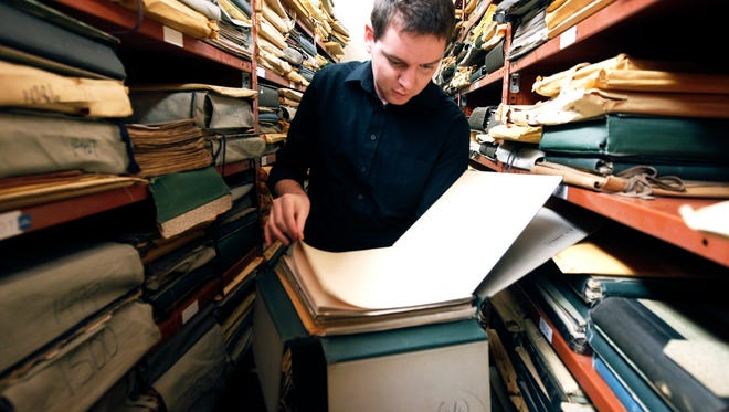 Matt Gray, assistant librarian at Music Hall looks at old sheet music Tuesday Nov. 10, 2015. There are a million pieces of music and 140 years of history in the library at Music Hall. Librarians are moving it to the main office of the The Public Library of Cincinnati and Hamilton County while Music Hall is under construction.