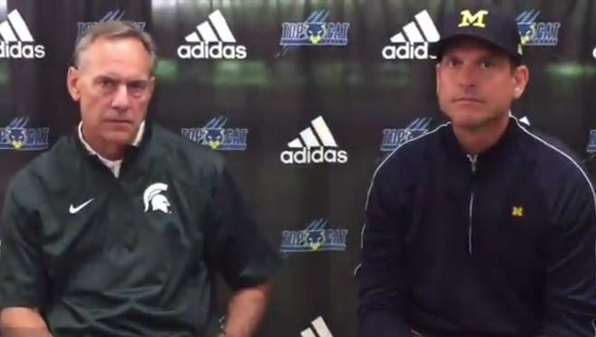 Michigan State's Mark Dantonio, left, and Michigan's Jim Harbaugh react to the death of Gordie Howe on Friday, June 10, 2016.