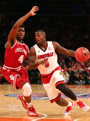 Dec 9, 2014; New  York, NY, USA; Louisville Cardinals guard Chris Jones (3) controls the ball against Indiana Hoosiers guard Robert Johnson (4) during the first half at Madison Square Garden. Mandatory Credit: Brad Penner-USA TODAY Sports
