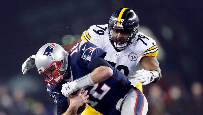 New England Patriots quarterback Tom Brady (12) is sacked by Pittsburgh Steelers nose tackle Javon Hargrave (79) in the first quarter in the 2017 AFC Championship Game at Gillette Stadium.