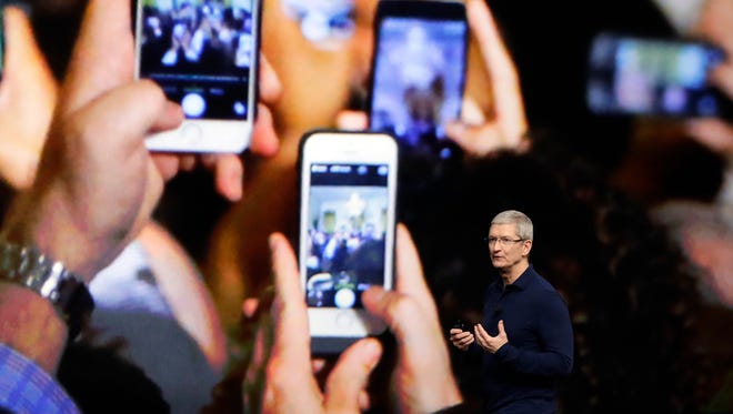 Apple CEO Tim Cook announces the new iPhone 7 during an event to announce new products Sept. 7, 2016, in San Francisco.