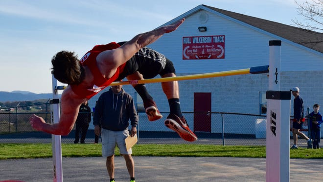 Riverheads' Hunter Allen clears the bar in the high jump during Wednesday's meet with Buffalo Gap and Fishburne Military School  at Riverheads High School. Allen won the event.