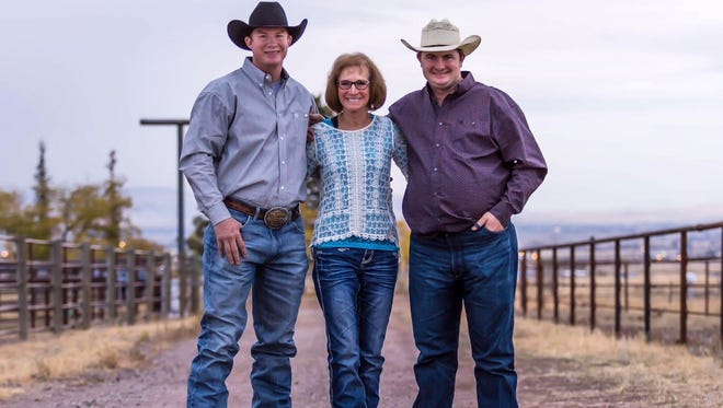 Rodeo star Ty Erickson, left, and his older brother Josh are pictured with their mother, Janet. The Erickson brothers are fast friends.