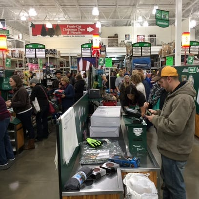 Shoppers pay for their purchases at Menards on Black