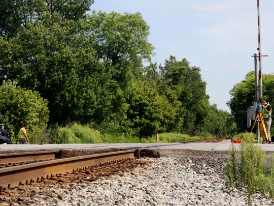West Chester Township police investigate a crash between an SUV and a train on Tuesday.