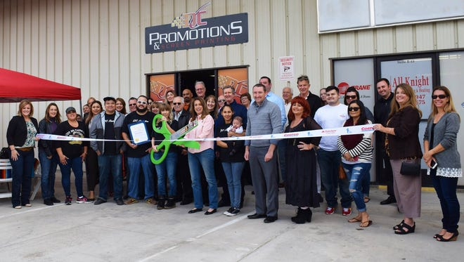 Members of the Greater Coachella Valley Chamber of Commerce attend a ribbon cutting.