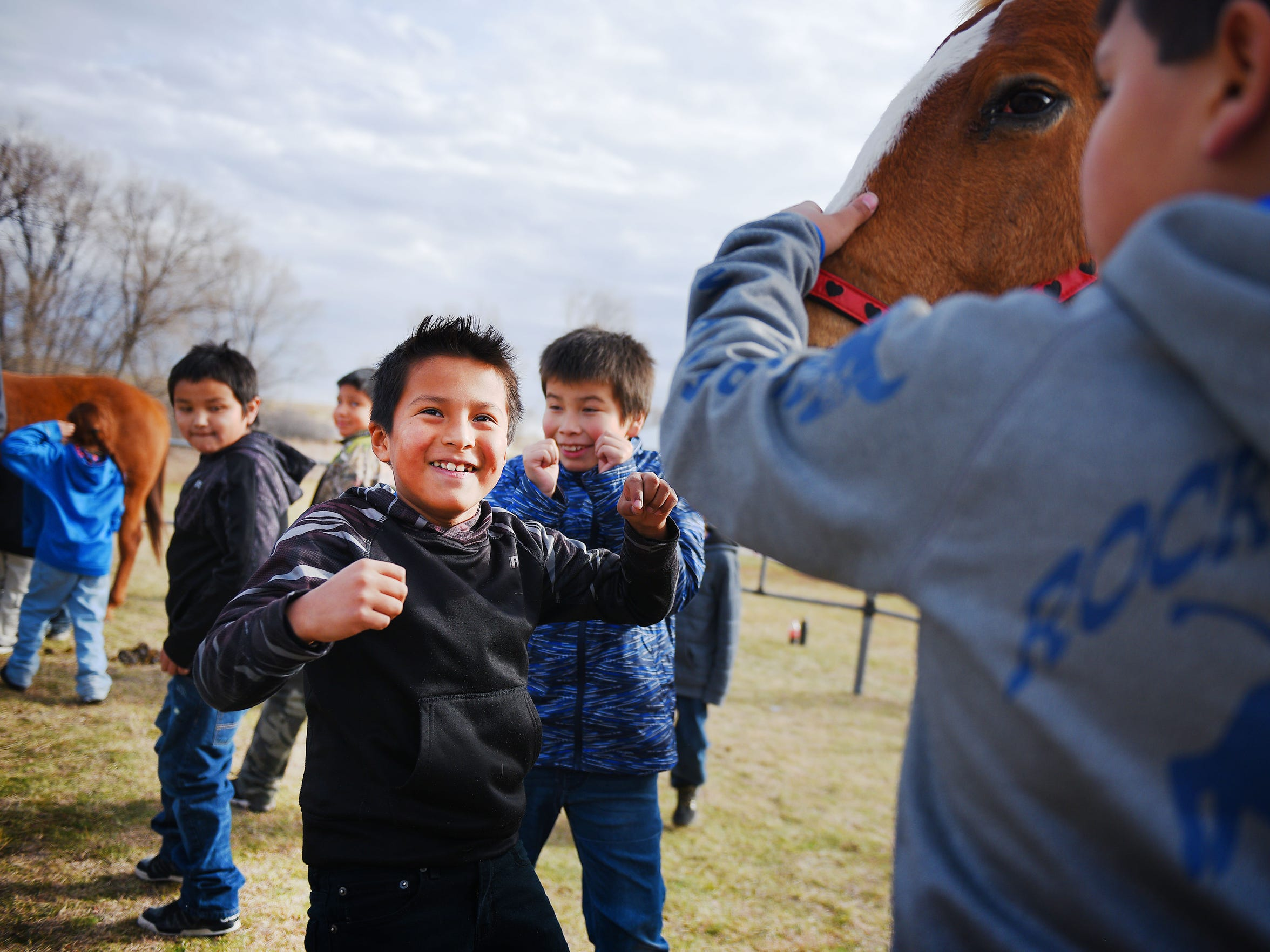 Tokahe runs toward the horse during animal therapy at He Dog Elementary School Tuesday, Nov. 14, in Todd County, South Dakota.