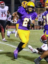 Smyrna's Blake Watkins gets around the end during a