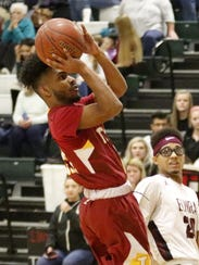 Luis Soto Marte of Ithaca puts up a shot Tuesday against
