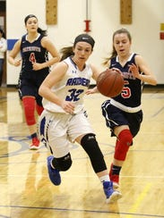 Alli Richmond of Horseheads dribbles down the court