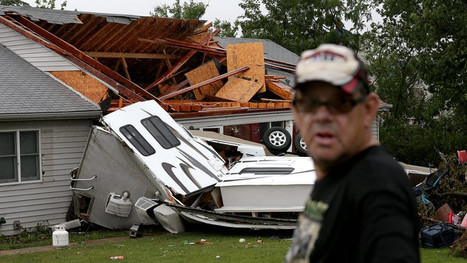 Plainfield homeowner Don Rackley talks about his neighbors' RV that flew into the roof of his home on East County Road 200 South in Plainfield, when a tornado tore through the neighborhood on Tuesday, June 24, 2014.