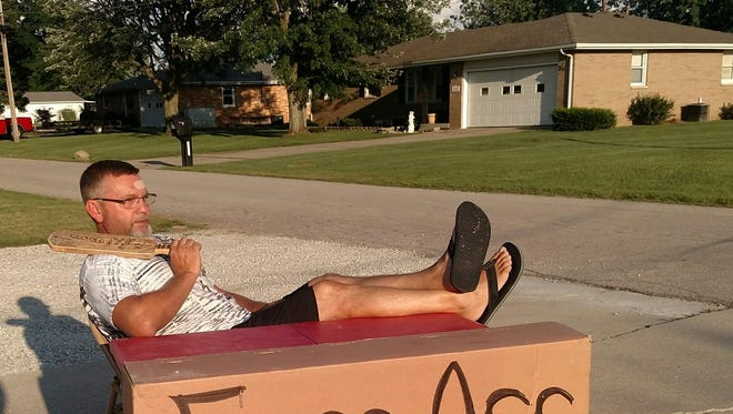 Dwayne Stamper Sr., a Muncie resident, sits along his driveway posing for a picture that went viral.